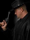 Perfil del hombre con el revólver occidental Foto de archivo libre de regalías