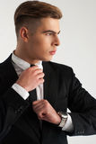 Perfil del novio serio en el traje Imagenes de archivo