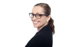 Perfil lateral de las gafas que desgastan de una mujer Imagenes de archivo