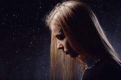 Perfil triste de la muchacha Fotografía de archivo