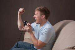 Perfile o retrato de um gamer excited Imagens de Stock Royalty Free