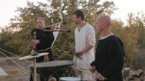 Perfomance medieval ensemble of monks Templars stock video