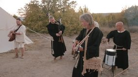 Perfomance medieval ensemble of monks Templars stock video footage