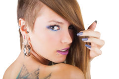 Perforaciones y tatuaje Foto de archivo libre de regalías