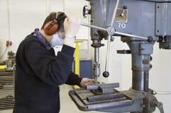 Perforadora y trabajador Foto de archivo libre de regalías