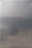 Perforated aluminum sheet for use as background Stock Image