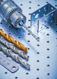 Perforated angle fasteners metal ruler drill and Stock Image