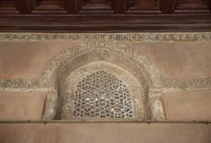 Perforated arched stucco window decorated with geometrical patterns and calligraphy at Ibn Tulun mosque, Cairo, Egypt. Perforated arched stucco window decorated royalty free stock photo