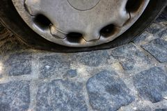 Perforated automobile tire. In the street royalty free stock photo