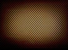 Perforated belägger med metall bakgrund med strålkastaren Royaltyfri Foto