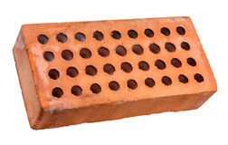 Perforated brick. By round holes, red fired clay, old earthenware, isolated with clipping path Stock Photo