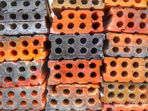 Perforated bricks piles with core holes royalty free stock photography