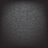 Perforated carbon fiber weave Royalty Free Stock Image