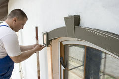Perforated cozy corner. Installing the perforated cozy corner on architectral element Stock Image