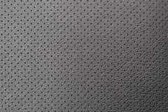 Perforated leather on the chair, black leather stock images