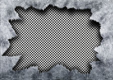Perforated mesh texture with torn iron metal background Royalty Free Stock Images