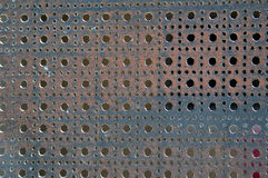 Perforated metal. Details of perforated metal fence royalty free stock photography