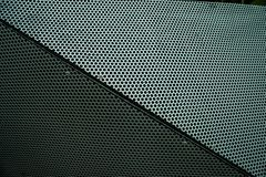 Perforated metal abstract cube edge stock photography
