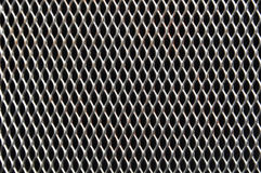 Perforated metal background Stock Images
