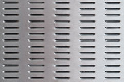 Perforated metal background Stock Image