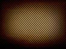 Perforated metal background with spotlight Royalty Free Stock Photo