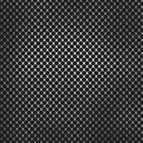 Perforated metal on carbon fibre background Stock Image