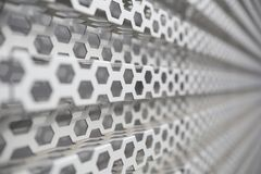 Perforated metal panel. Metal background Stock Photos