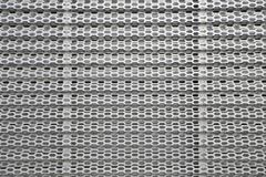 Perforated metal panel. Metal background Stock Image