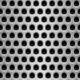 Perforated metal plate. Royalty Free Stock Photography