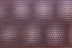 Perforated metal rusty surface Stock Image