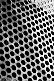 Perforated metal sheet with scraped surface Royalty Free Stock Images