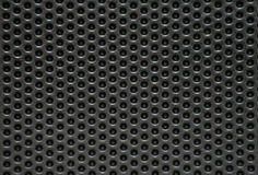 Perforated metal surface Stock Photos