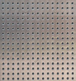 Perforated metal surface texture Stock Images