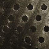 Perforated metal surface, textured background Stock Photo