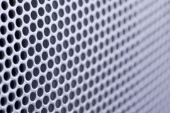 Perforated metal texture. Diminishing perspective of an perforated metal texture Royalty Free Stock Image