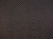 Perforated metal texture background Stock Photos