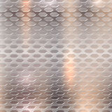 Perforated metallic background brushed polished copper texture, created with gradient mesh. Royalty Free Stock Photos