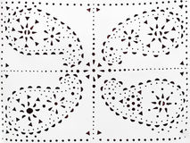 Perforated paisley pattern on white leather Royalty Free Stock Photos