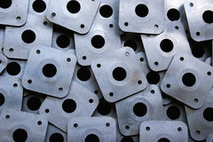 Perforated plates. Rows of perforated metal plates . Construction elements Stock Photography