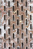 Perforated rusty metal Royalty Free Stock Image
