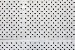 Perforated silver metal surface, industrial background Stock Photo