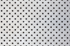 Perforated silver metal surface, industrial background Stock Image