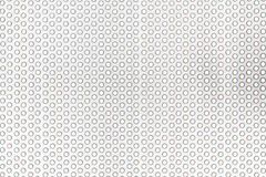 Perforated stainless steel in bright light Stock Image