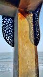 Perforated wood panel decorate seaside gazebo Royalty Free Stock Photography