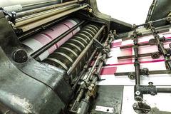 Perforation machine and print cards. View of a part of a machine in a paper industry. It shows part of machine in work process Royalty Free Stock Image