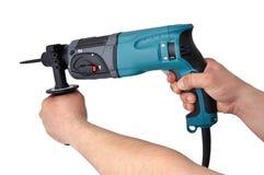 Perforator in hand Stock Photo