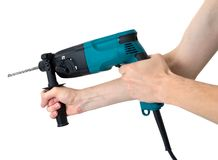 Perforator in hands  isolated on a white Royalty Free Stock Image