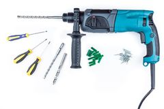 Perforator and screwdriver with screws. On a white background Royalty Free Stock Images