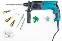Perforator and screwdriver with screws. On a white background Stock Photos