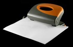 Perforatore con il foglio di carta Fotografia Stock